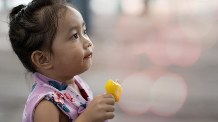 Asian girl eating ice cream
