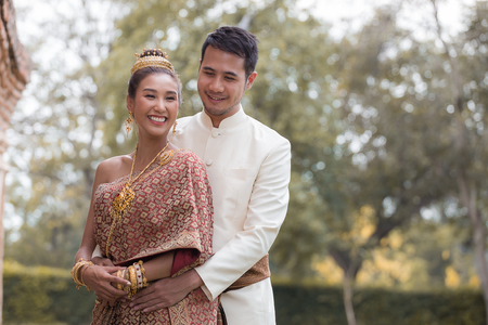 Happy Couples in Thai National Dress Stock Photo