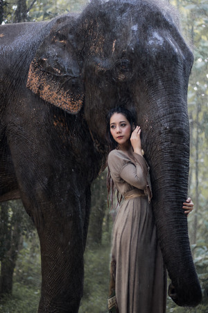Asian woman and elephant