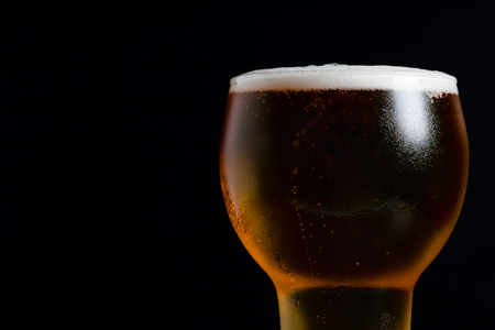 glass of beer on black background Stock Photo