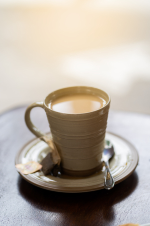 Hot coffe on the table in the morning