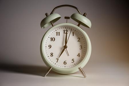 Vintage alarm clock with light.