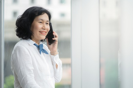 Asian middle business woman are calling for business success concept