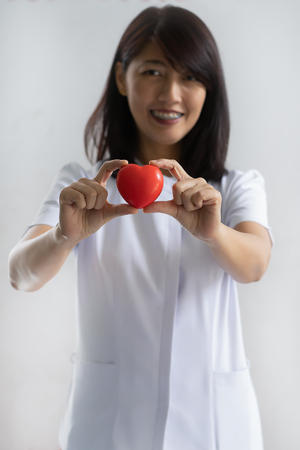 Nurse showing heart model in hospital Stock Photo