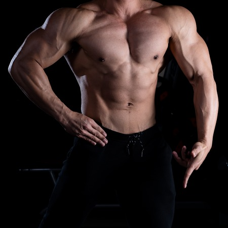 Fitness man showing six pack
