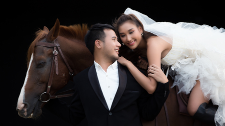 Married couple with a horse