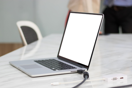 Mock up of laptop in meeting room Stock Photo