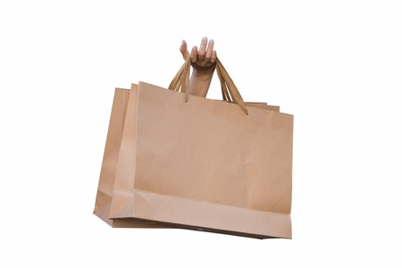 Hand holding shopping bags isolate on white background. Stock Photo