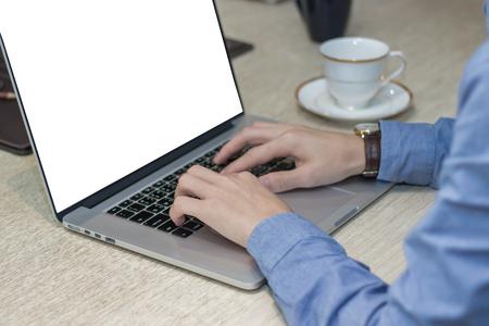 Mock up of businessman using laptop.