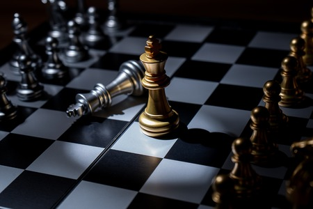 Chess board game for business concept in light and shadow. Stock Photo