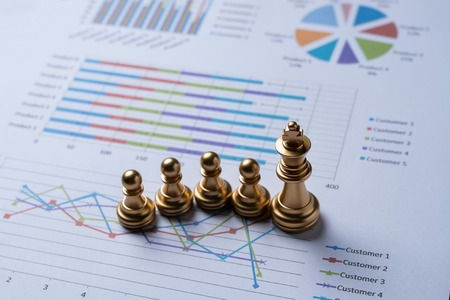 Chess on business report.business and financial concept. Reklamní fotografie