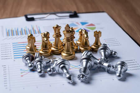 Chess on business report.business and financial concept. Imagens