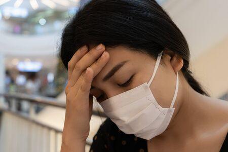 Asian women wearing dust masks