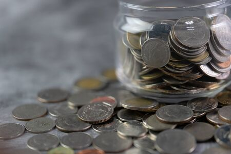 Coins in a glass jar Savings and investment savings