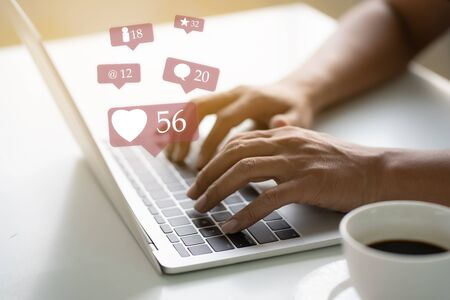 Asian man hands using laptop for social media marketing ecommerce concept 版權商用圖片