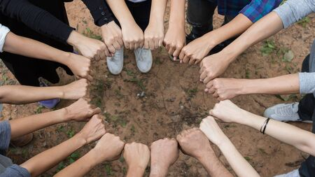 Young people putting their hands together. teamwork concept Imagens - 150183755