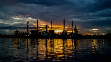 The silhouette of a refinery In Sunrise