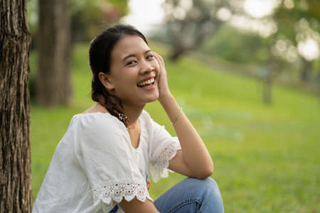 Happy Asian woman in the garden