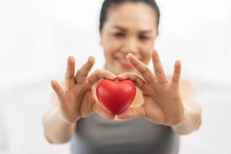 Pregnant women are holding heart on hand 免版税图像