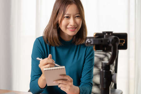 Beautiful Asian girl shop online are broadcasting live products via social media.