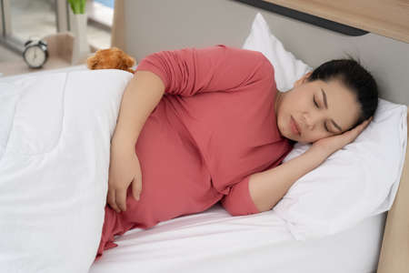 Pregnant women are sleeping in the daytime. 免版税图像