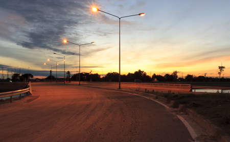 and streetlights: The middle of the road near the back of the sun and sky