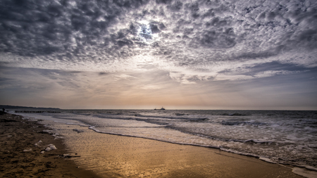 Beautiful beach scene and blue cloudy sky near Vlissingen, Zeeland, Holland, Netherlands