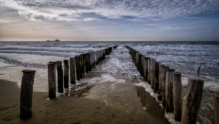 View on the wooden pier during sunset at Vlissingen, Zeeland, Holland, Netherlands