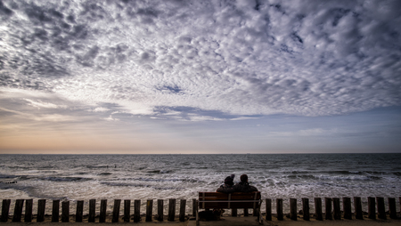 Silhouette of a couple at the pier in pier in Vlissingen, Zeeland, Holland, Netherlands
