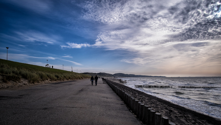 View along the pier with sunny weather and clouds in Vlissingen, Zeeland, Holland, Netherlands Stock Photo