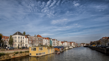 Big canal in Middelburg with houseboats and traditional dutch houses
