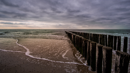 Wooden pier during cloudy weather at the beach in Vlissingen, Zeeland, Holland, Netherlands