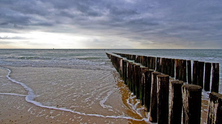 Pier during cloudy weather at the beach in Vlissingen, Zeeland, Holland, Netherlands