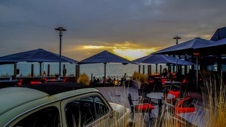 Vlissingen, Zeeland, Holland  Netherlands - October 2017: Restaurant near the beach with an old timer in it Editorial