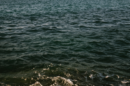 Dark green blue water surface near tropical island [Thailand, Fuji 160C]