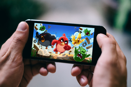 COLOGNE, GERMANY - FEBRUARY 27, 2018: Angry Birds App Game played on Apple iPhone