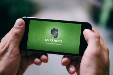 COLOGNE, GERMANY - MARCH 02, 2018: Closeup of iPhone Screen with EVERNOTE LOGO