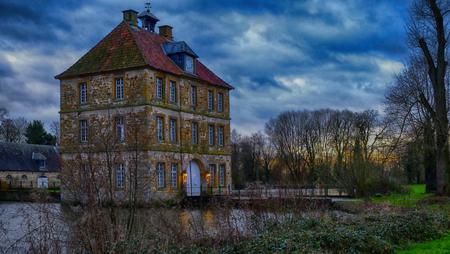 Historic Water Castle Schloss Tatenhausen in Kreis Guetersloh, North Rhine-Westphalia, Germany Stock Photo