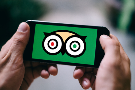 COLOGNE, GERMANY - MARCH 10, 2018: Closeup of iPhone Screen showing TRIPADVISOR MESSENGER LOGO or ICON Editorial