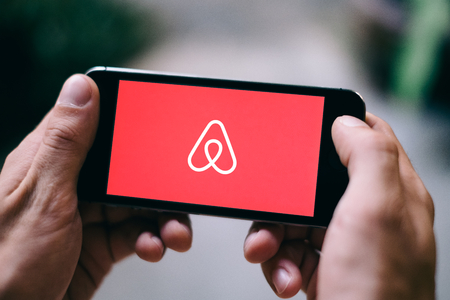 Closeup of iPhone screen with AIRBNB LOGO