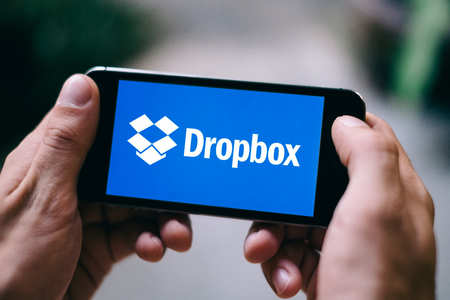 Closeup of iPhone screen with DROPBOX APP LOGO and ICON