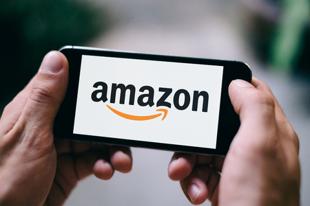 Closeup of iPhone screen with white AMAZON APP LOGO and ICON