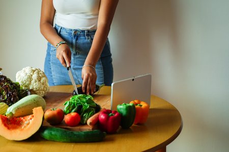 Woman hands cutting vegetables in the kitchen. Housewife slicing fresh salad. Vegetarian and healthy cooking concept - Image Standard-Bild - 123888866