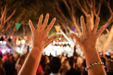 Party outdoor - hands up celebrating fest concert event - focused image - Youth,fest,event,music, and entertainment concept - Image - Standard-Bild - 123888870