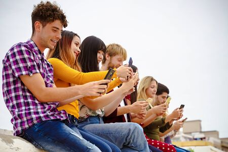Teenagers watching videos and social media on smartphones - Addiction to new technology trends - Concept of youth, tech, social and friendship ? ?? Image Standard-Bild - 134767080