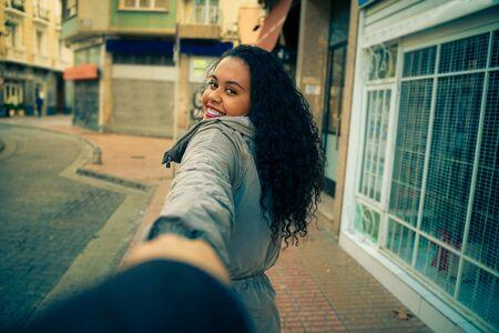 Teenage girl convincing her boyfriend to have a walk - Smiling her new boyfriend - focus on face - image Standard-Bild - 131918837