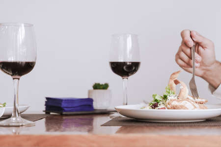 Portrait of a hand with food and wine. Food, drink and romantic concept.