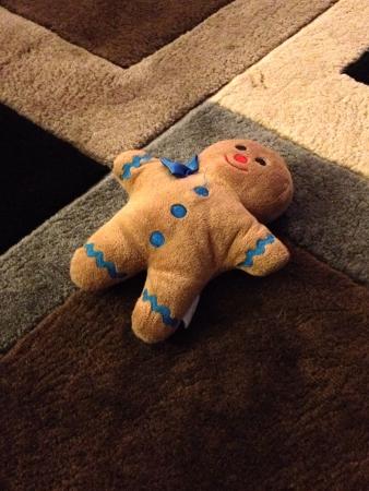 stuff: A stuff gingerbread man doll on the carpet floor  Stock Photo