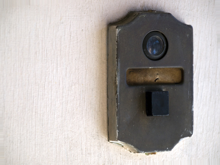 60s era doorbell with peephole