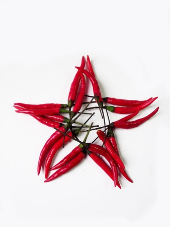 Red star  pepper isolated on a white background Stock Photo - 13088331